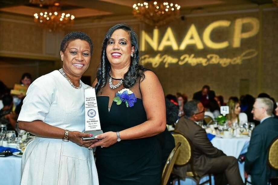 NAACP Greater New Haven Branch President Doris J. Dumas, right, presents the Cornell Scott Health Award to Ena Williams at a previous Freedom Fund dinner.