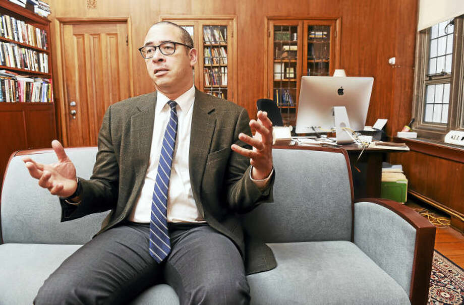 Yale College Dean Jonathan Holloway is photographed in his office at Sheffield-Sterling-Strathcona Hall in New Haven during an interview. He is leaving to take the position of provost at Northwestern University.