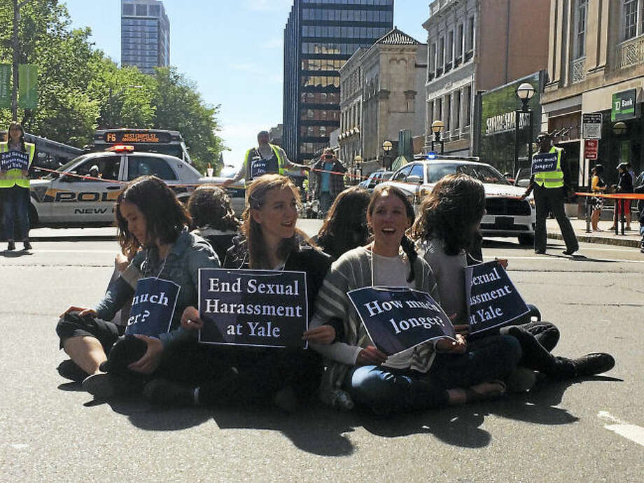 Yale University Local 33 graduate student union members protest to end sexual harassment at the school, during a demonstration at the intersection of Chapel and College streets in New Haven Thursday.