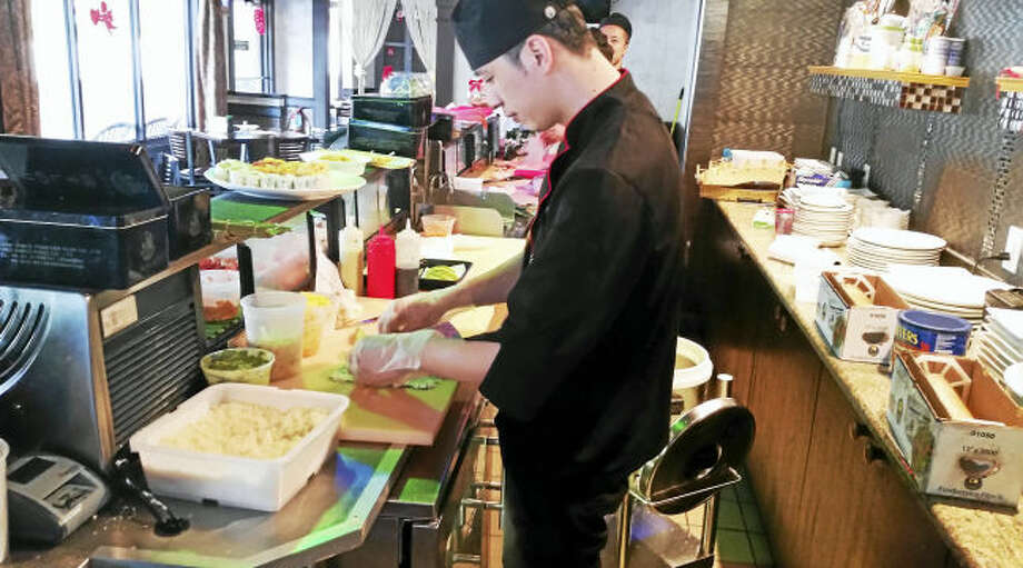 A sushi chef prepares for the lunch crowd at Koi Sushi, 185 Main St. in East Haven.