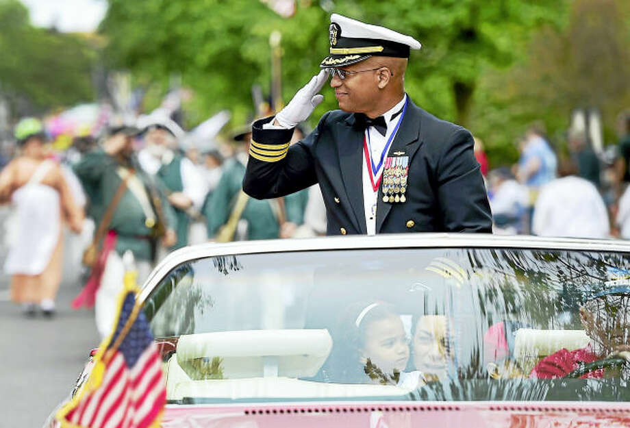 Milford, Connecticut: May 28, 2017. Grand Marshal Michael Thomas, a U.S. Navy Commander, salutes during the Milford Memorial Day Parade Sunday.