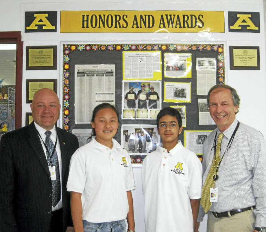 From left, Superintendent Charles Dumais, Clair Yuan, Kabir Khwaja and Principal Richard Dellinger.