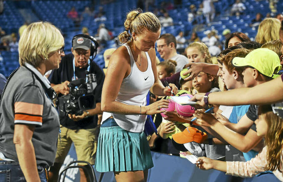 Petra Kvitova signs autographs after defeating Eugenie Bouchard in a 2016 match at the Connecticut Open in New Haven.