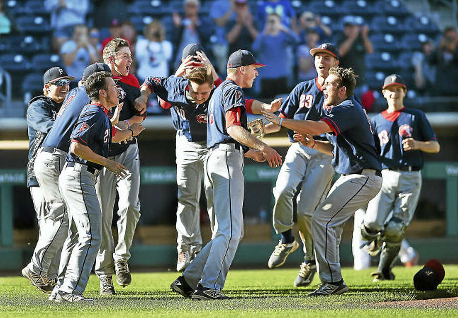 Foran celebrates their 10-5 win over Watertown, Wednesday in the CIAC class L semifinal game at Dunkin Donuts Park in Hartford.