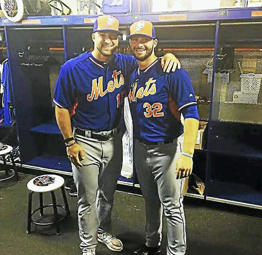 Milford's Joe Zanghi, right, poses with former NFL quarterback and Zanghi's current minor-league baseball teammate Tim Tebow inside the Columbia Fireflies' clubhouse.