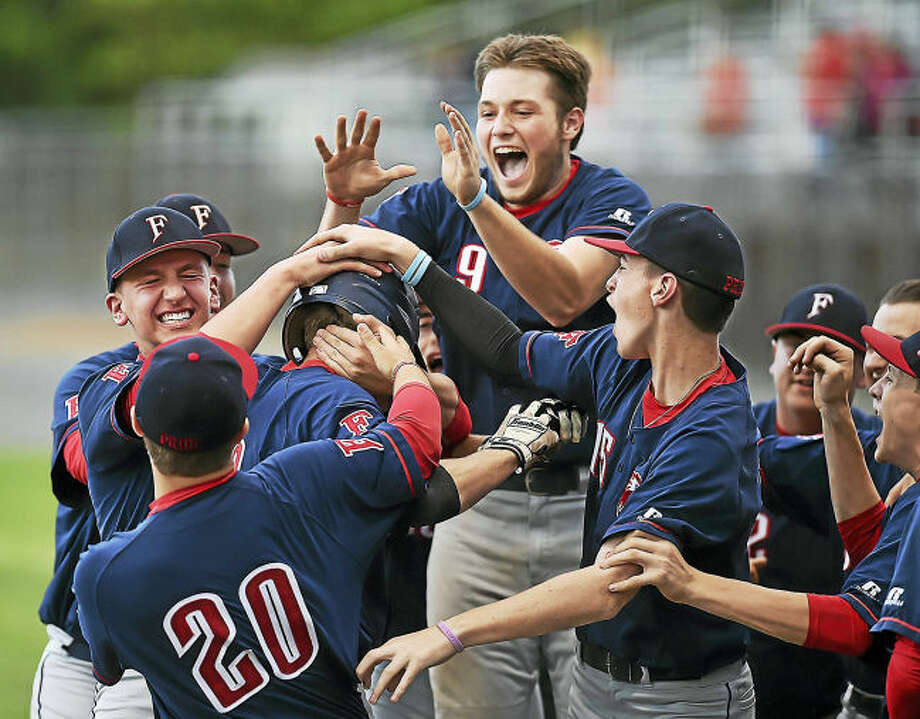 Foran shortstop Justin Lanese is greeted at home plate after hitting a two-run homer in an 8-2 win over North Haven in the CIAC Class L baseball championship June 10 at Palmer Field in Middletown.