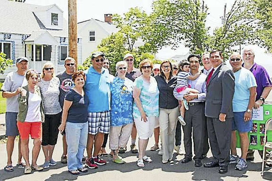 CONTRIBUTED PHOTO West Haven Mayor Ed O'Brien and state Sen. Gayle Slossberg, D-Milford, meet with West Haven neighbors.