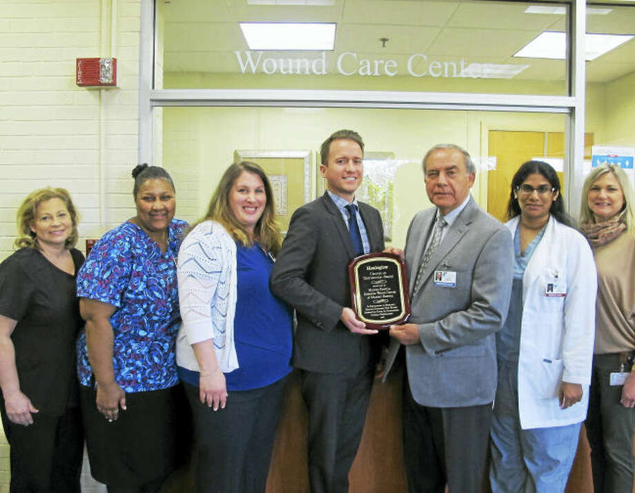 From left, Janice Mezick, RN, clinical manager; Dorothy Bridges, RN; Christina Newton, MPH program director; Josh Cogdill, Healogics assistant vice president; Joseph Pelaccia, president, CEO, Milford Hospital; Dr. Seby Jacob, wound care specialist; and Laurie Sheehan, office assistant.