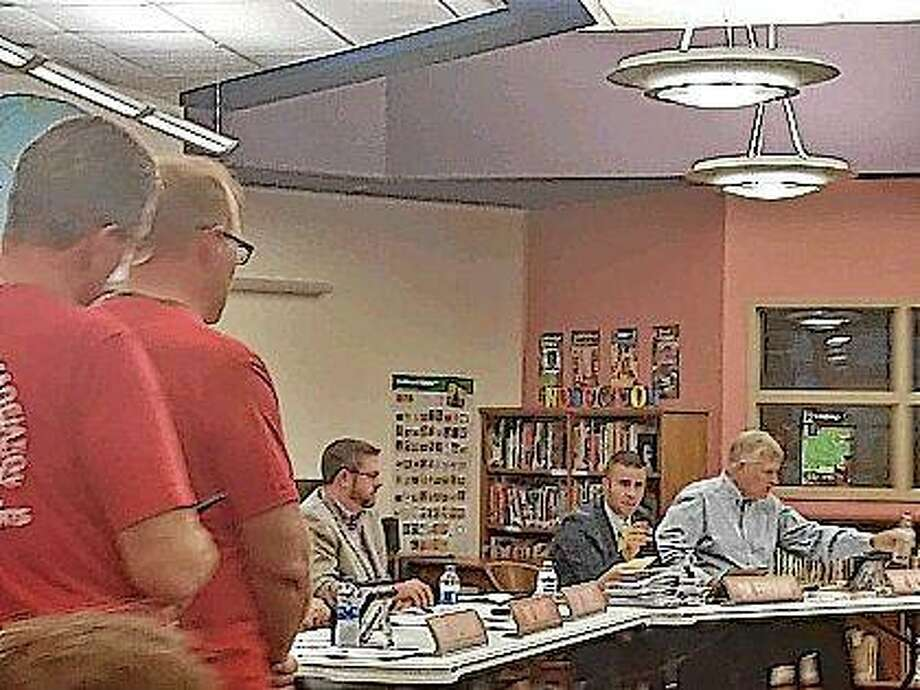 New Berlin board members discuss issues brought to the board by the New Berlin Education Association.