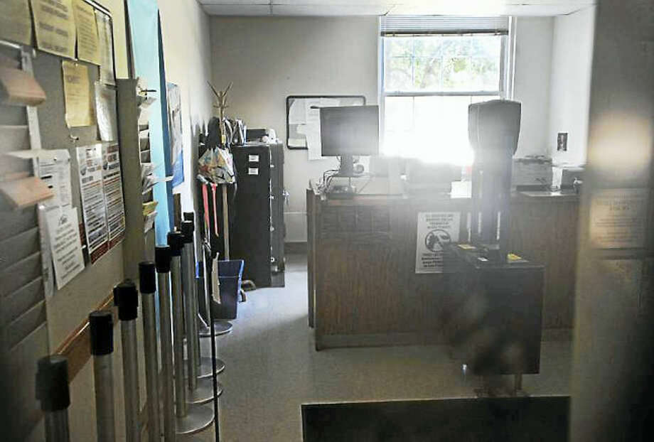 The darkened office of the closed Department of Motor Vehicles office Tuesday at the Parsons Government Center in Milford.