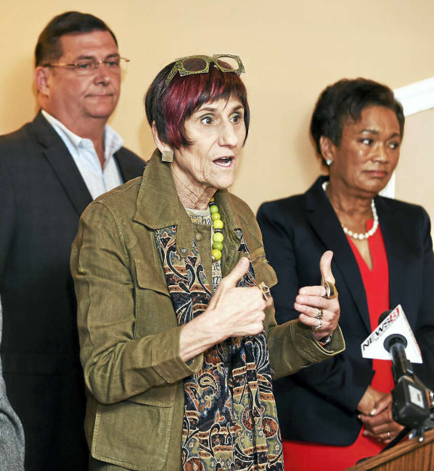 U.S. Rep. Rosa DeLauro, center, speaks with the press following a meeting with mayors and first selectmen from Connecticut's 3rd District on Tuesday at Brazi's Italian Restaurant in New Haven. At left is West Haven Mayor Edward O'Brien and at right is New Haven Mayor Toni Harp.