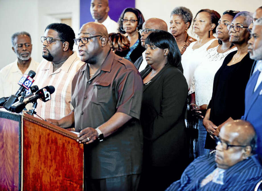 Rev. Boise Kimber (at podium) flanked by clergy and other New Haven faith community members address the violence in Charlottesville and President Donald Trump's statements concerning the violence at a press conference in New Haven on 8/16/2017. Arnold Gold / Hearst Connecticut MediaRev. Boise Kimber (at podium) flanked by clergy and other New Haven faith community members address the violence in Charlottesville and President Donald Trump's statements concerning the violence at a press conference in New Haven on 8/16/2017. Arnold Gold / Hearst Connecticut Media