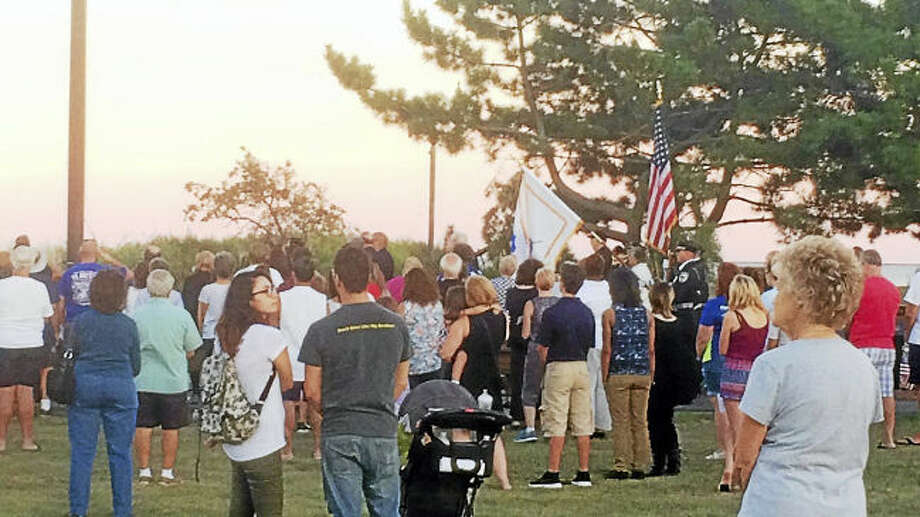 (Wes Duplantier/The New Haven Register) ° Dozens of people turned at West Haven's Bradley Point Beach early Sunday evening for a ceremony and candlelight vigil in memory of the Sept. 11 attacks. U.S. Sen. Richard Blumenthal, U.S. Rep. Rosa DeLauro and local officials also spoke at the ceremony.Dozens of people attended a ceremony and candlelight vigil at West Haven's Bradley Point Beach in memory of the Sept. 11 attacks. Speakers included U.S. Sen. Richard Blumenthal, U.S. Rep. Rosa DeLauro and local officials.