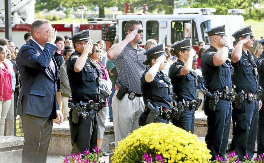 Milford Police take part in a 9/11 ceremony in front of Platt Technical High School in Milford on September 11, 2017. Arnold Gold / Hearst Connecticut MediaMilford police take part in a 9/11 ceremony in front of Platt Technical High School in Milford on Monday.
