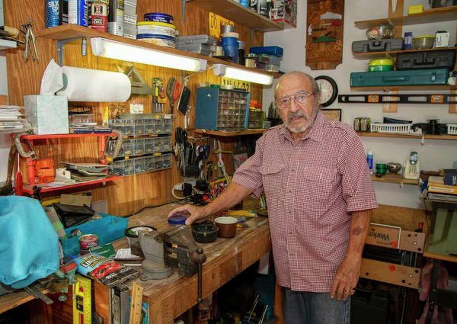 In this Oct. 9, 2019 photo, Joe Schiavone, 81, stands in his workshop in West Melbourne, Fla. Schiavone will get a modest cost-of-living increase from Social Security for 2020,a political year in which many Democrats are calling for a boost in basic benefits and a more generous formula to compute annual inflation adjustments. (AP Photo/Mike Brown) / FR171726 AP