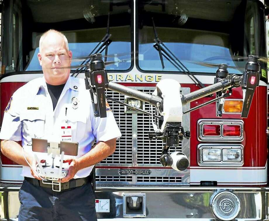 Orange Fire Marshall Tim Smith demonstrating a DJI Inspire 1 drone the fire department received from a $3000 grant from FM Global to the Orange Fire and Police Departments to test drone capabilities in firefighting and police work. 13 members of the Orange Fire and Police Departments have been trained and certified to fly the drone