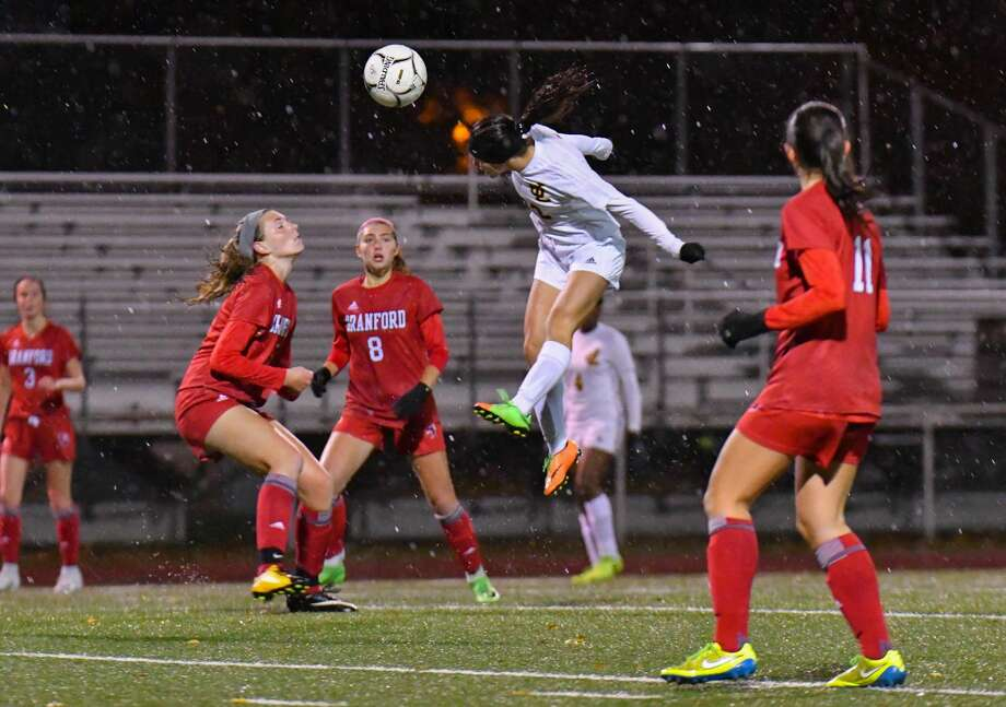 Jonathan Law's Jocelyn Wirth (22) heads a ball during Tuesday's Class L opening round game against Branford in Milford.