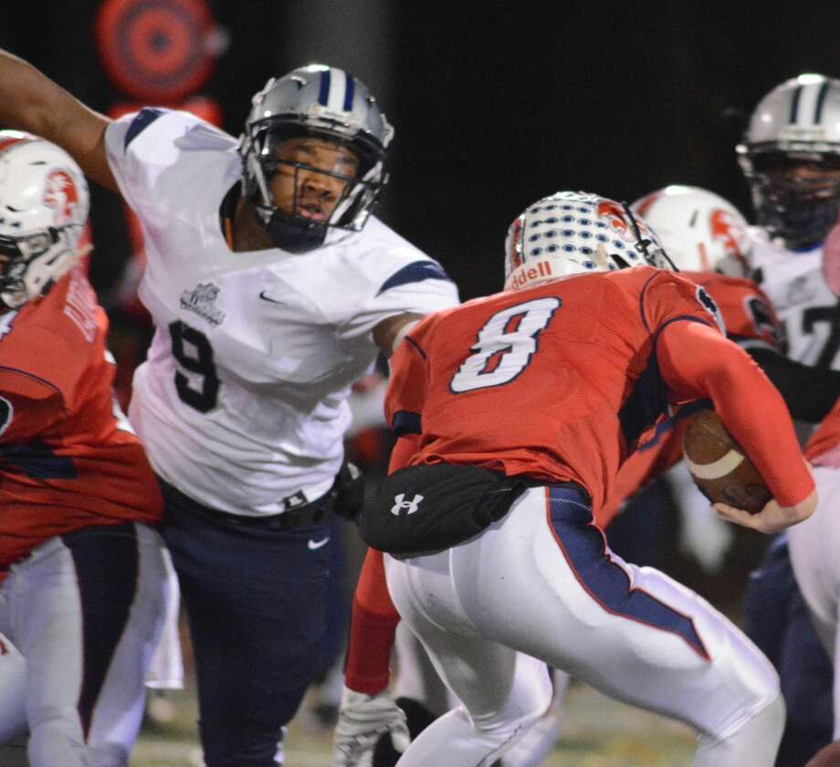 Hillehouse's Prince Boyd Jr. tackles Foran QB Jared Hubler during Friday's game.