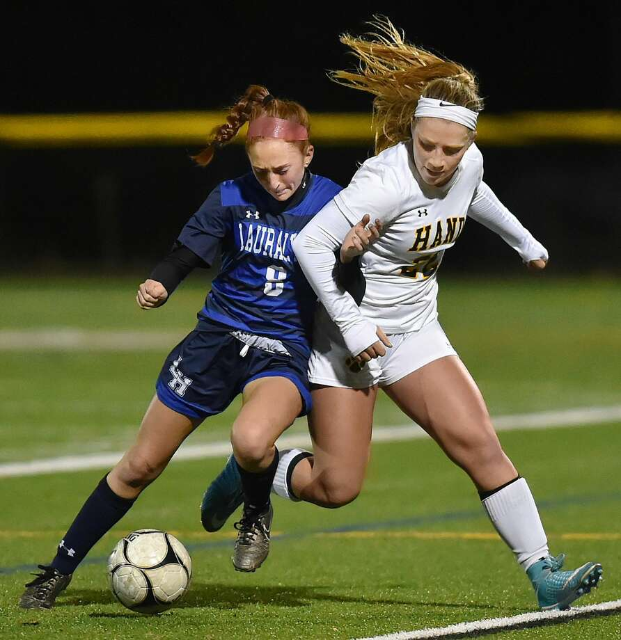 Hand senior captain Gabby Egidio controls the ball as Lauralton Hall junior Emma Koerner defends in the second round of the Class L state soccer tournament, Thursday, Nov. 9, 2017, at Strong Field at the Surf Club in Madison. Hand won, 3-0.