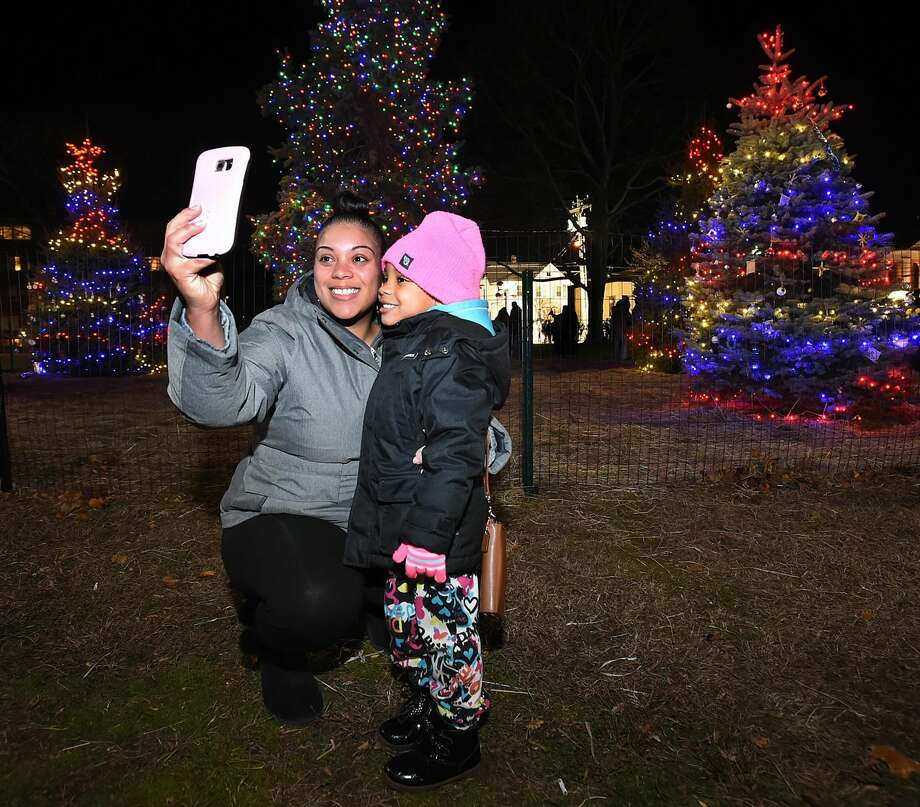 A West Haven mother takes a selfie with her child following the annual lighting of the Christmas tree on the Green in West Haven, Saturday, November 26, 2016. (Catherine Avalone/New Haven Register)