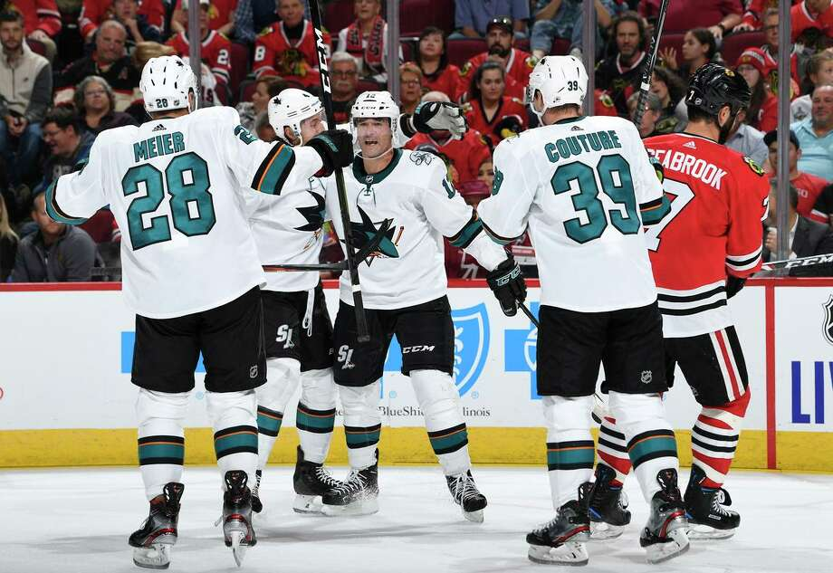 The Sharks' Brenden Dillon and Patrick Marleau (middle) react after Marleau scored in the second period against the Blackhawks in Chicago. Marleau signed a one-year deal with the Sharks this week. Photo: Bill Smith / NHLI Via Getty Images / 2019 NHLI