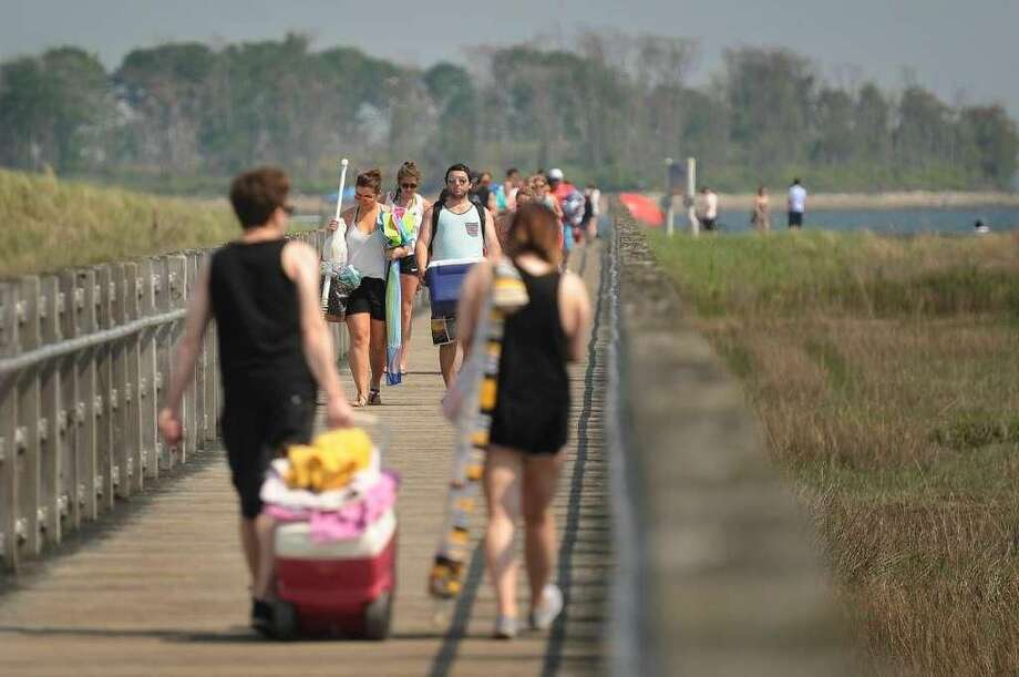 A boardwalk links the beach from the parking area at Silver Sands State Park in Milford. Legislation that cleared the Senate early Friday would delay a $10-million improvement project there until after June 30, 2019.