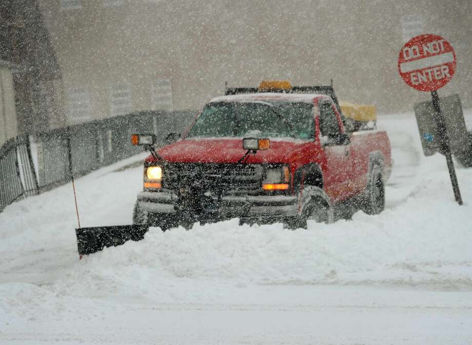 Blizzard conditions on River Street in downtown Milford, Conn. on Thursday.