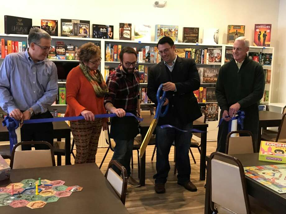 Chamber Chairman Dewey Forbes, State Rep. Kim Rose, Owner Ryan McConnell, Mayor Benjamin Blake and Chamber Executive Director Gary Mullin perform the ribbon cutting ceremony..
