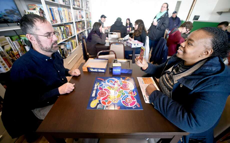 Keith Iodice (left) of Fairfield and Sandy Booth of Norwalk play Brain Games at Hawkwood Games in Milford.