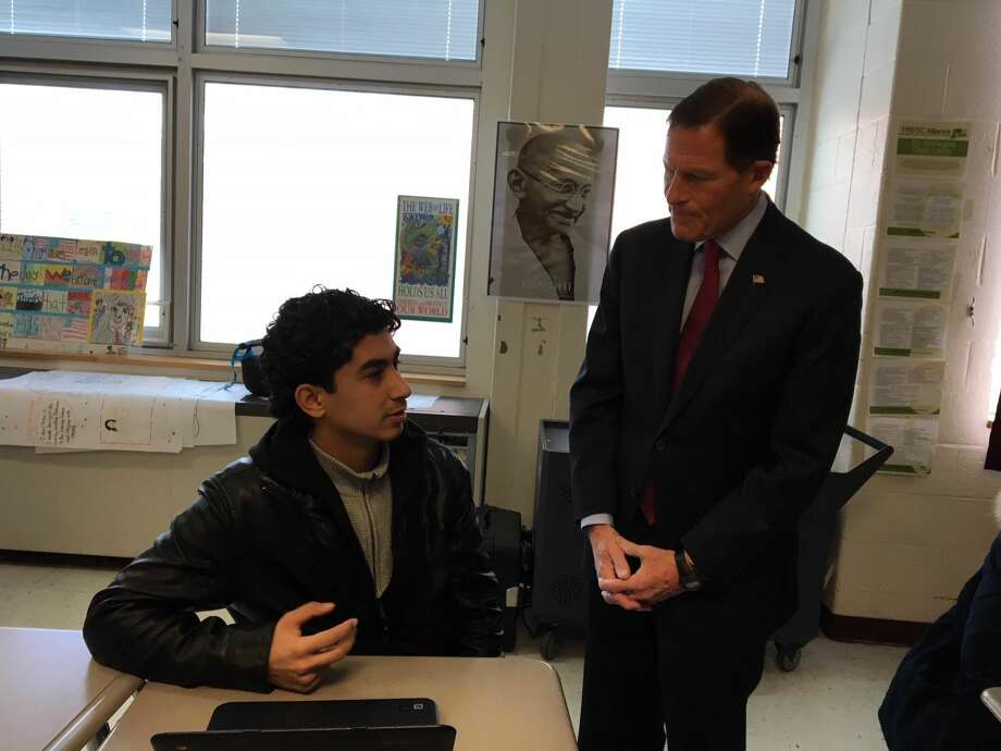 At left, Omar Moussa,17, a refugee from Syria talks with U. S. Sen. Richard Blumenthal at Cross High School.
