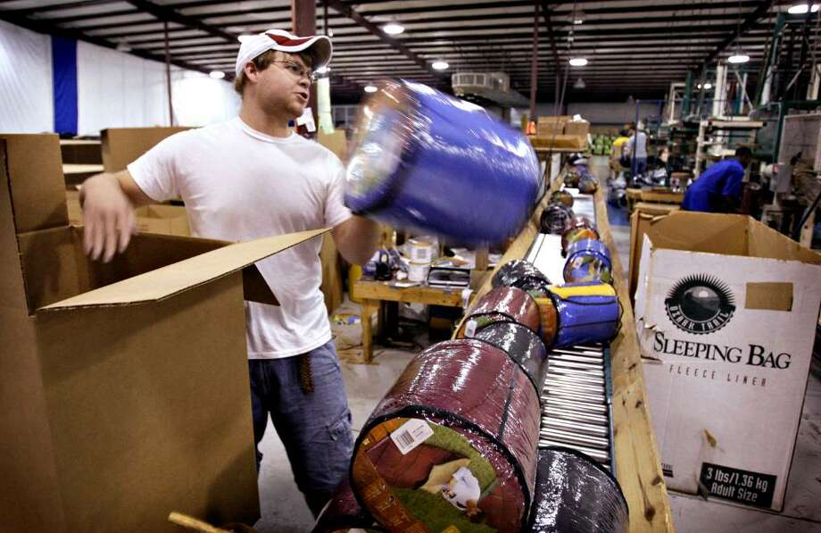 Cody Lodeg boxes up finished sleeping bags at the Exxel Outdoors Inc. plant in Haleyville, Alabama, U.S., on Tuesday, Sept. 16, 2008. Exxel is cutting production in Shanghai while hiring workers, adding machines and increasing output in Haleyville. The U.S. dollar's 18 percent drop against the yuan since 2005 and rising wages in China prompted Exxel's pullback. Photographer: Gary Tramontina/Bloomberg News Photo: GARY TRAMONTINA, BLOOMBERG NEWS