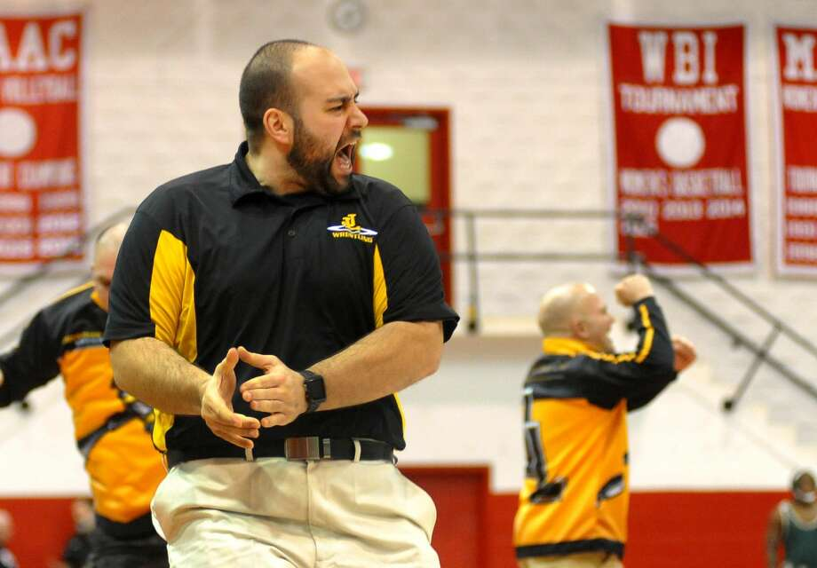 Jonathan Law Assistant Coach Mark Ruzbarsky cheers after Kevin Brocksom defeated Shelton's Ray Weiner during SCC Wrestling Championship action in Fairfield, Conn. on Saturday Feb. 10, 2018.
