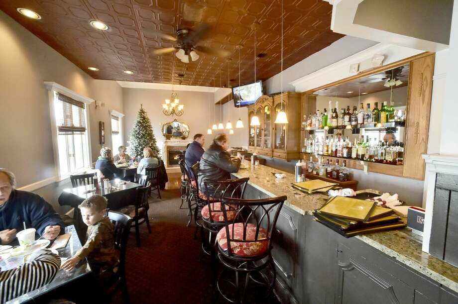 One of three dining rooms includes a bar at the Kimberly Restaurant in Milford.