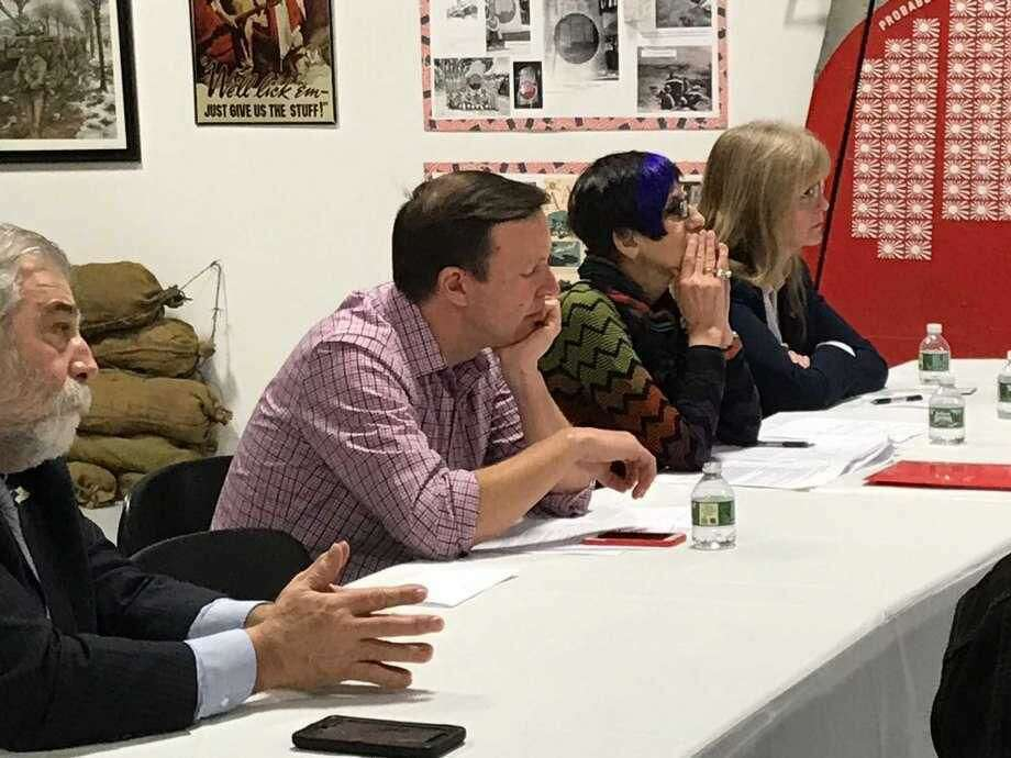 U.S. Sen. Chris Murphy, D-Conn., (shown at center), U.S. Rep. Rose DeLauro, D-3, and West Haven Mayor Nancy Rossi listen to veterans' health care concerns Saturday during a forum at the West Haven Veterans Museum.