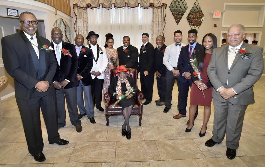 Annie Louther, 103, a special award recipient as the The West Haven Black Coalition Inc. Woman of Distinction, seated center, surrounded by other honorees, left to right standing, Curtis McBride, Edwin Blackwell, Troy Tappin, Ronald M. Douglas, Unique Flynn, Joe Gibson, Jr., Clifton E. Graves, Jr., James L. Chapman, Jr. aka D.J. Tootskee, Dillon Swaine, Richard Miller, Jania Alexis Stewart-James, and Donald R. Lewis.