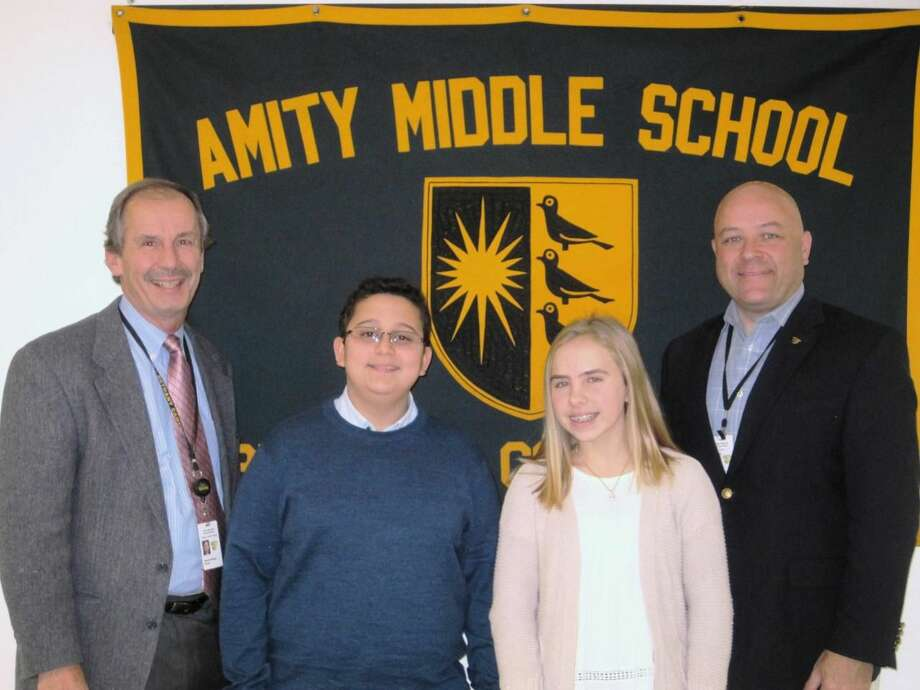 From left,  Dr. Richard Dellinger, Principal; Robert Farbman; Samantha Cantalupo; and Dr. Charles Dumais, Superintendent.