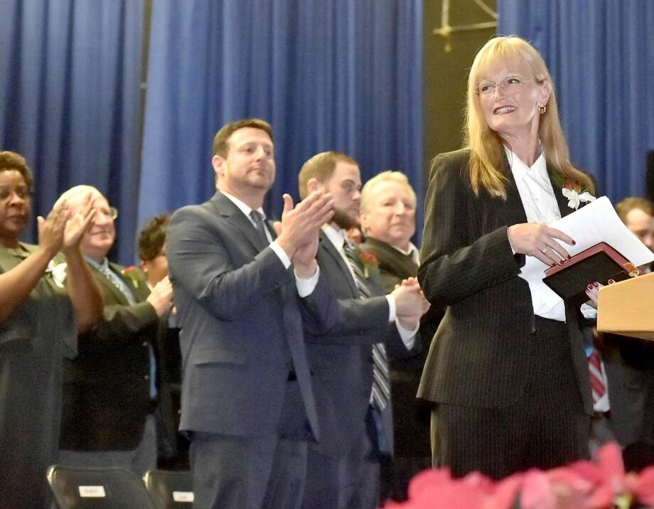 West Haven Mayor Nancy Rossi is applauded after giving her inaugural address as the first woman mayor of West Haven during the City of West Haven Inaugural ceremonies at West Haven High School.