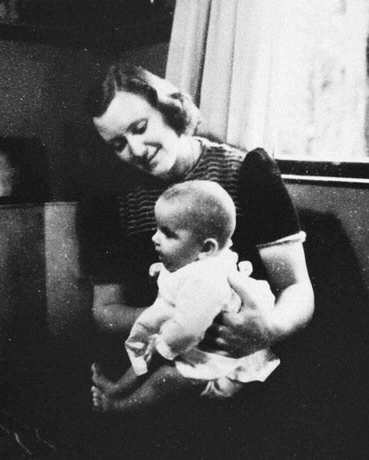 This picture was take in Holland during War War II. Pictured here is Marion Pritchard, who as part of her Nazi resistance efforts sheltered a family of four that included three children, one of them, a baby Erica, is pictured here on her lap. The two reunited years later and Erica, now in her 70s, flew in from Holland to see the late Pritchard honored for her efforts.