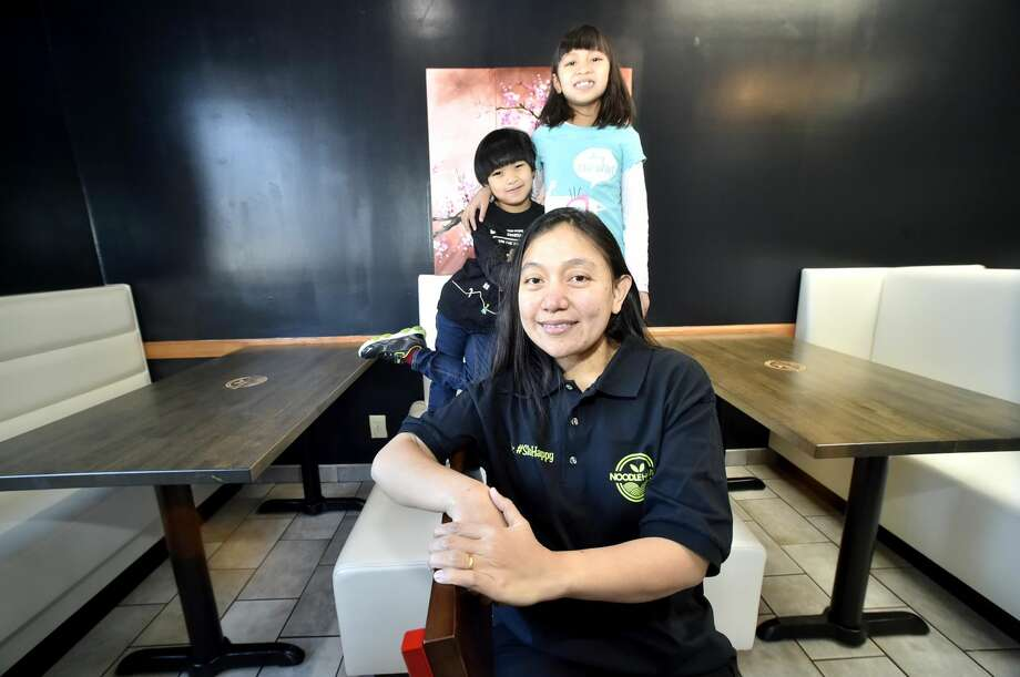 Soraya Kaoroptham, owner of the new Noodle House on the Boston Post Road in Orange with her son A.J. Kaoroptham, 5, and daughter Anaya Kaoroptham, 8, at the restaurant.