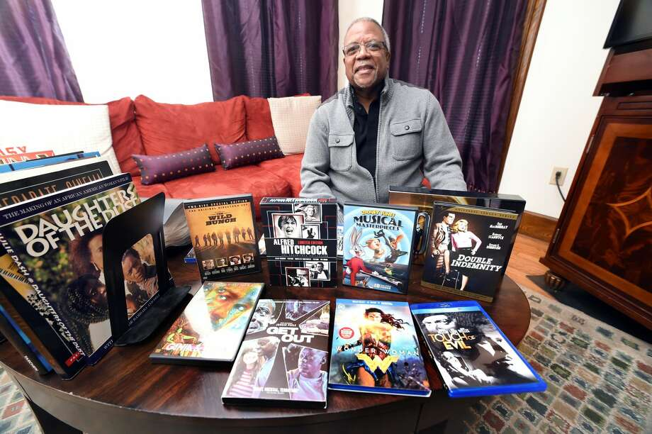 Steve Fortes is photographed with some of his favorite movies at his home in New Haven.