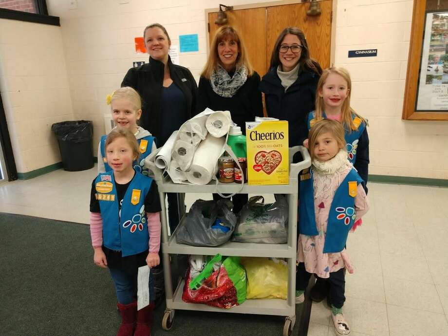 From left, Julia Chernesky, Alison McMillan, Angela Chernesky, Co-Leader, Mary Ellen LaRocca accepting the donation for Woodbridge Human Services, Nicole Chick, Co-leader, Lynnea Youngberg, and Cecilia Chick.