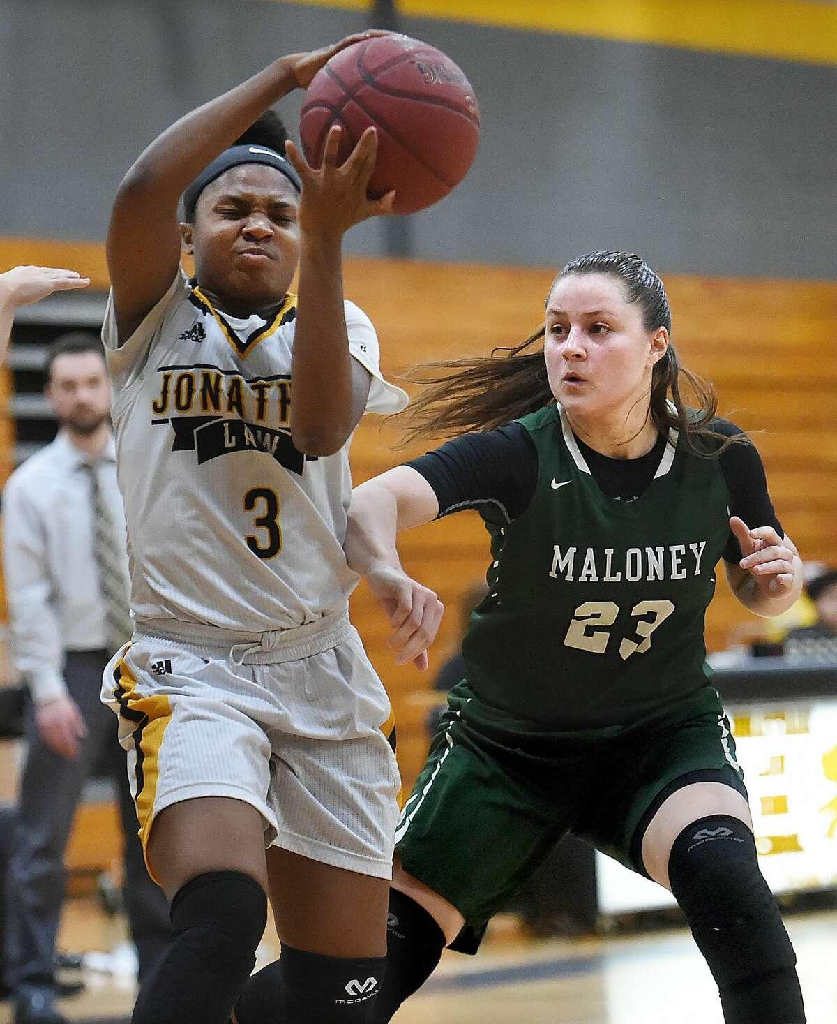 Law junior captain Samara Thacker makes a move on Maloney senior Melanie Polanco Tuesday, in a Class L first-round Game in Milford.