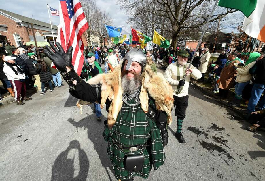 Dave Conroy with the Irish Heritage Society of Milford waves to the crowd during the annual St. Patrick's Parade on Broad St. in Milford on March 10.