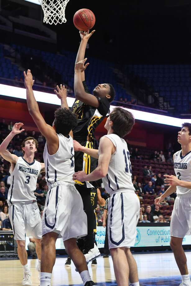 Amity's Brian Curtin shoots a short jumper during the Division II championship game on Saturday.