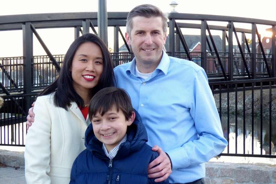 Milford resident James Maroney, a Democrat who is looking to fill State Sen. Gayle Slossberg's seat in the 14th district, is pictured at the announcement of his candidacy with his wife, Dr. Jennifer Ju, and their son, Jay.