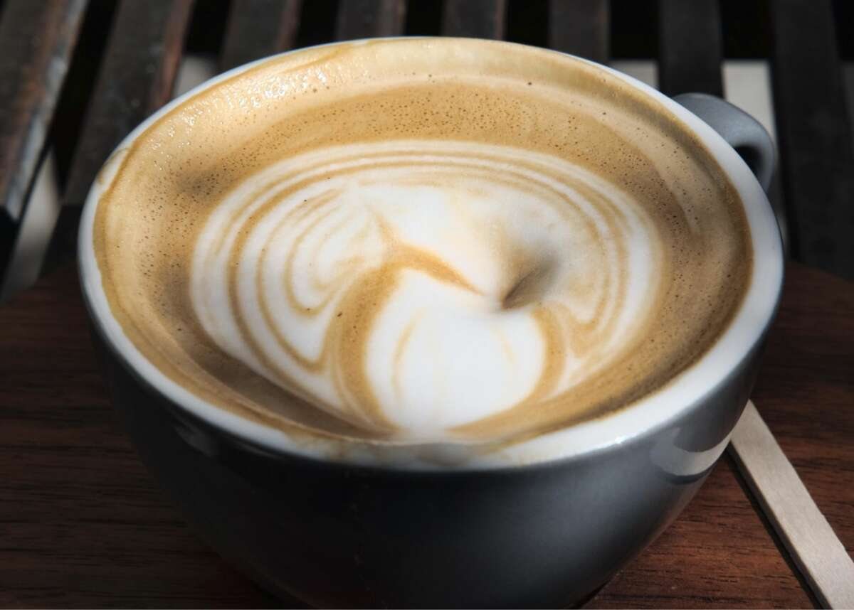 In this Thursday, March 29, 2018, photo, steamed milk floats atop a cup of coffee at a cafe in Los Angeles. Superior Court Judge Elihu Berle has ruled that California law requires coffee companies to carry an ominous cancer warning label because of a chemical produced in the roasting process. Judge Berle wrote in a proposed ruling Wednesday, March 28, 2018, that Starbucks and other coffee companies failed to show that the threat from a chemical compound produced in the roasting process was insignificant. At the center of the dispute is acrylamide, a carcinogen found in many cooked foods, that is produced during the roasting process. (AP Photo/Richard Vogel)