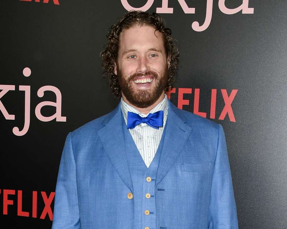 "FILE - In this June 8, 2017 file photo, actor T.J. Miller attends the premiere of Netflix's ""Okja"" in New York. Miller was arrested Monday night, April 9, 2018, at LaGuardia Airport in New York and charged with calling 911 to falsely claim that a woman on the same train as him had a bomb in her luggage. Prosecutors said Miller called in the false bomb information on March 18 after getting into a verbal confrontation with a woman on a train traveling from Washington D.C. to New York. The train was stopped in Westport, Conn., where it was searched. (Photo by Evan Agostini/Invision/AP, File)"