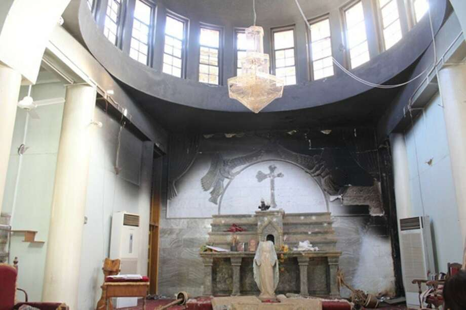 A church in Karamles, Iraq, damaged by ISIS. The Knights of Columbus are rebuilding this town with a $2 million commitment. A Mass for persecuted Christians in Iraq and Syria will be held Sunday at St. Mary Roman Catholic Church in New Haven.