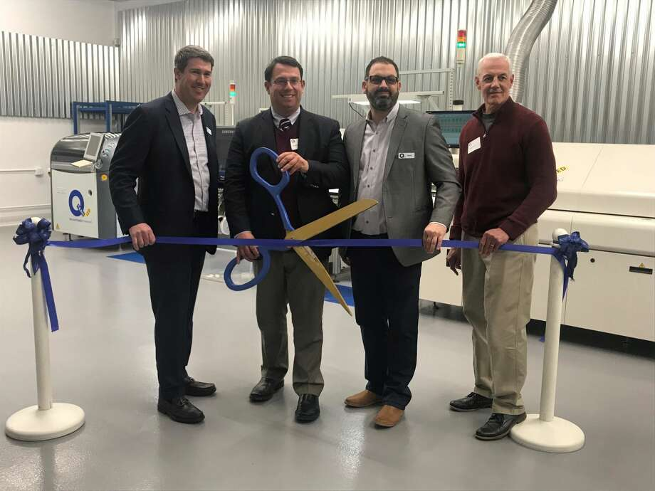 From left, Gean Tremaine, president of Q Tran; Mayor Ben Blake; David LaVigna, Q Tran COO; and chamber executive director Gary Mullin cut the ribbon at the Q Trans celebration.