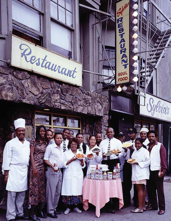 Sylvia Woods and her employees outside the restaurant.